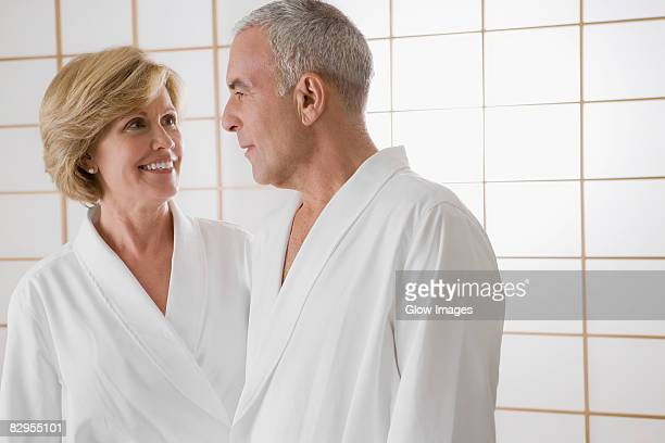 Mature woman and a senior man standing in the bathroom