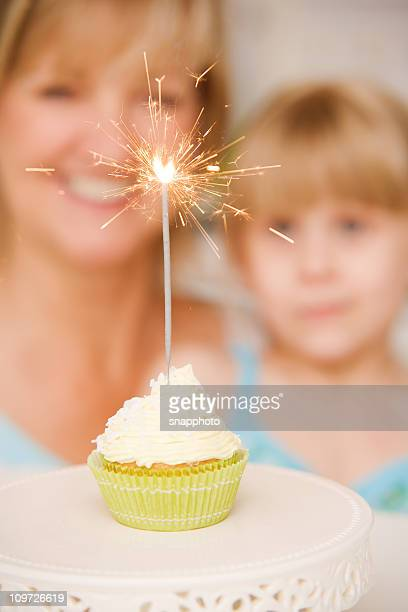 Mature Woman and Child Sparkler Cupcake