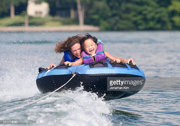 mature woman and girl tube on wisconsin lake. - vilas_county,_wisconsin stock pictures, royalty-free photos & images