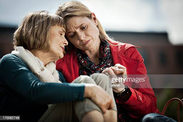 mature woman and her daughter - grief stock pictures, royalty-free photos & images