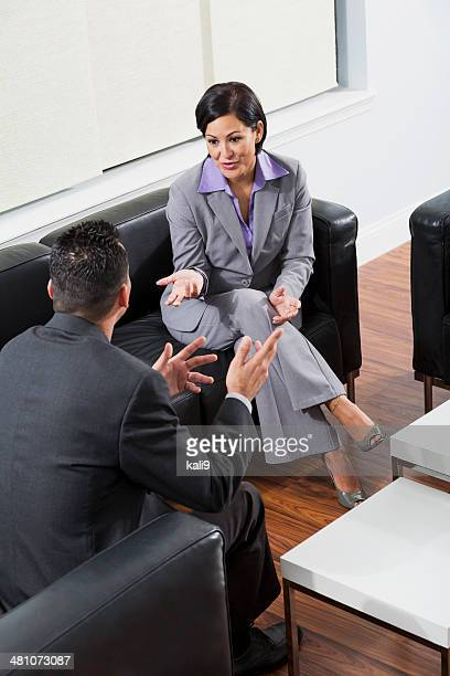 Mature woman and man having business meeting in office