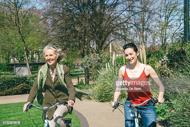 Mature Woman And Young Woman Cycling