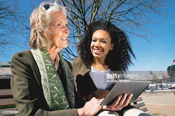 Mature Woman And Young Woman Using Digital Tablet