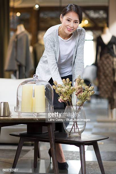 mature woman arranging flowers in her store - design occupation stock pictures, royalty-free photos & images