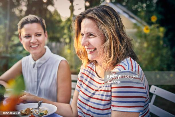 Mature woman at dinner party in garden