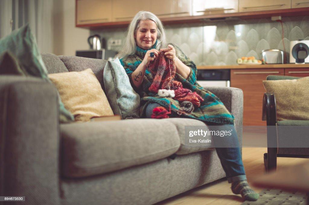 Mature woman at home : Stock Photo