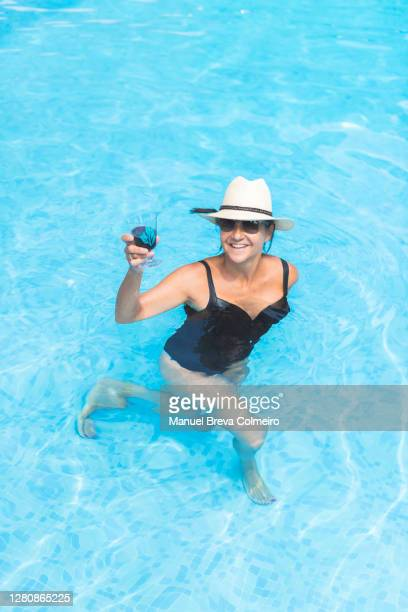 mature woman at the swiming pool - benicassim stock pictures, royalty-free photos & images