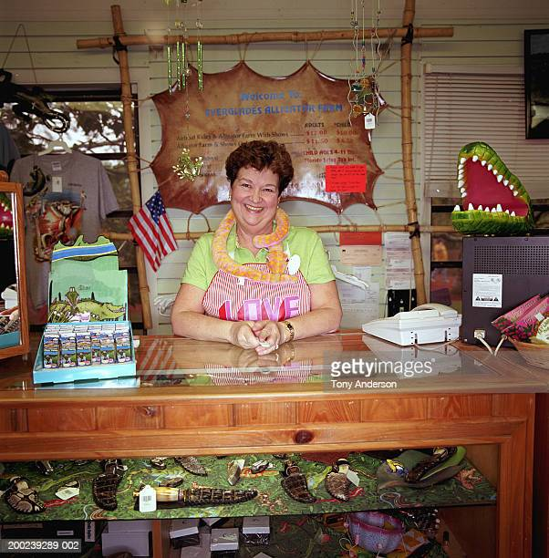 Mature woman behind counter in gift shop, portrait