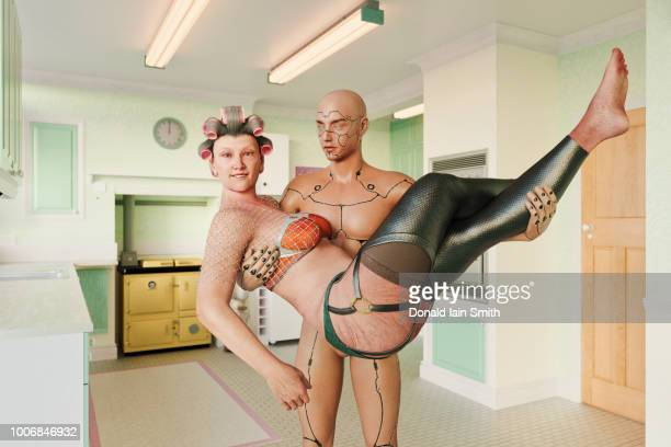 mature woman being carried in arms of male cyborg at home in kitchen - digital desire fotos stock-fotos und bilder