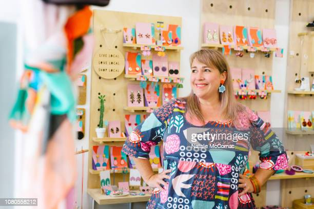 mature woman business owner in store - entrepreneur stock pictures, royalty-free photos & images