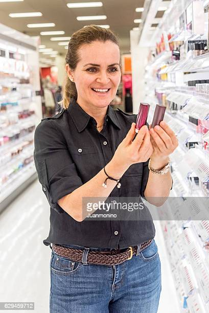 Mature woman buying cosmetics