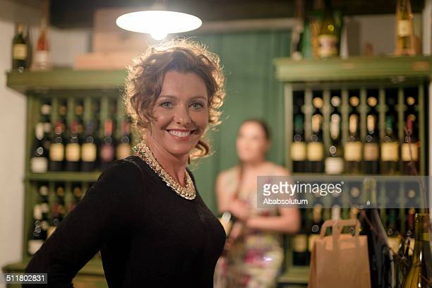 Mature Woman Buying Wine, Cellar in Europe