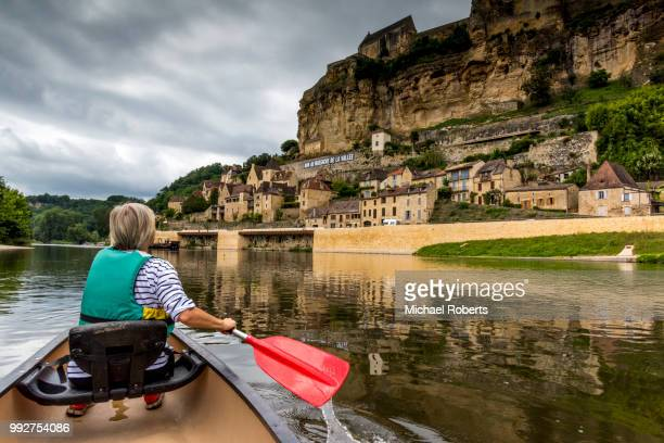 Mature woman canoeing on the River Dordogne at Beynac-et-Cazenac