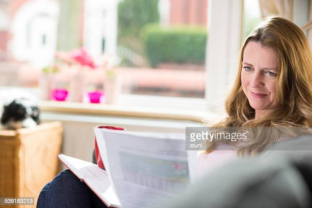 mature woman checking her paperwork