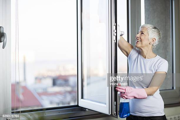 Mature woman cleaning home
