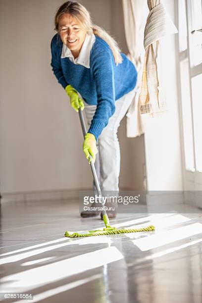 Mature Woman Cleaning the Floor