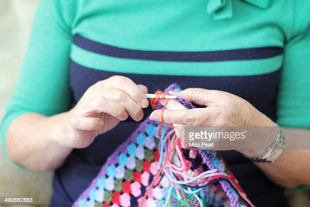 Mature woman crochet in close-up