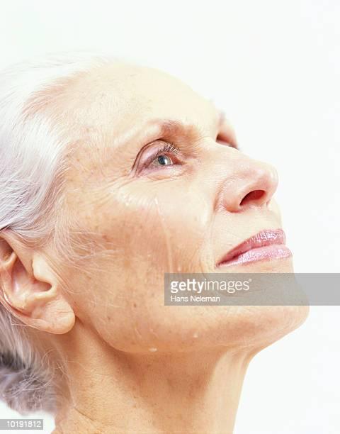 Mature woman crying, profile, close-up