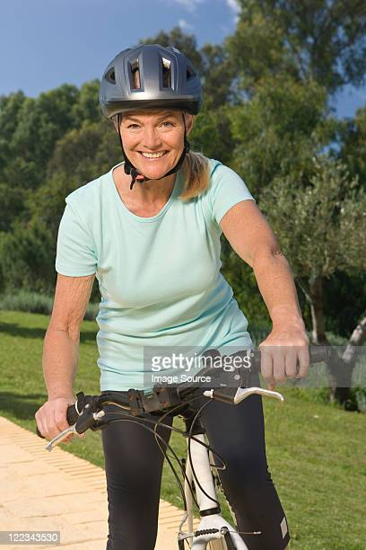 Mature woman cyclist wearing helmet
