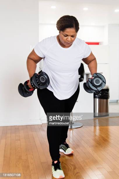 "mature woman doing exercise at home. - ""martine doucet"" or martinedoucet stock pictures, royalty-free photos & images"