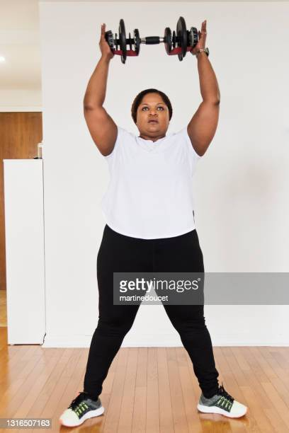 """mature woman doing exercise at home. - """"martine doucet"""" or martinedoucet stock pictures, royalty-free photos & images"""