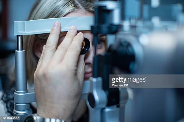 Mature woman doing eye test at the optometrists