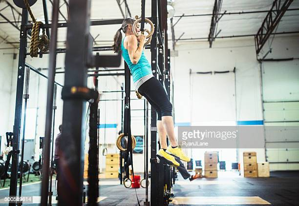 Mature Woman Doing Pull Ups on Rings