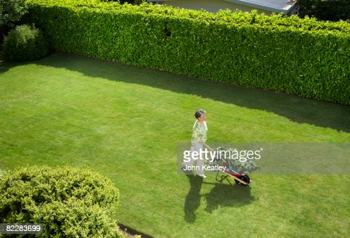 Mature Woman Doing Yard Work Stock Photo Getty Images