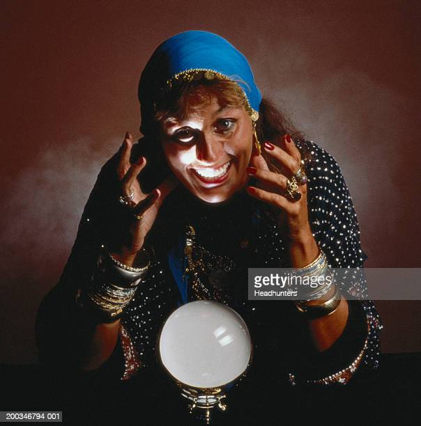 mature woman dressed as gypsy smiling - headhunters stock pictures, royalty-free photos & images