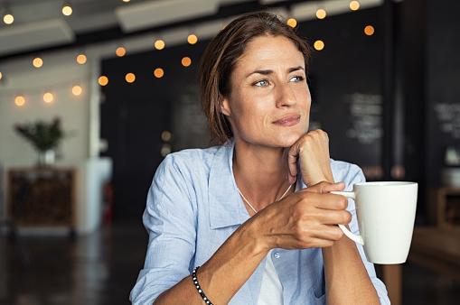 Mature woman drinking coffee 1040303968