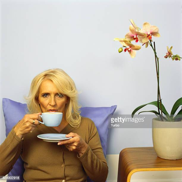 Mature Woman Drinking from Cup