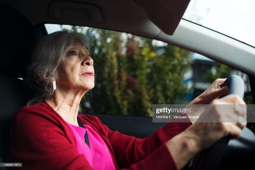 Mature woman driving : Stock Photo