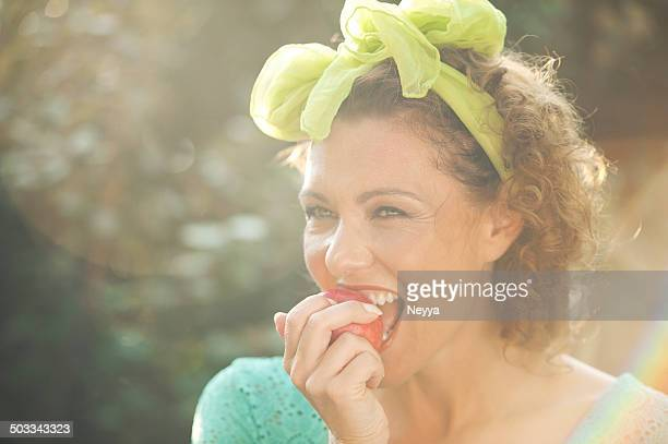 Mature Woman Eating Apple