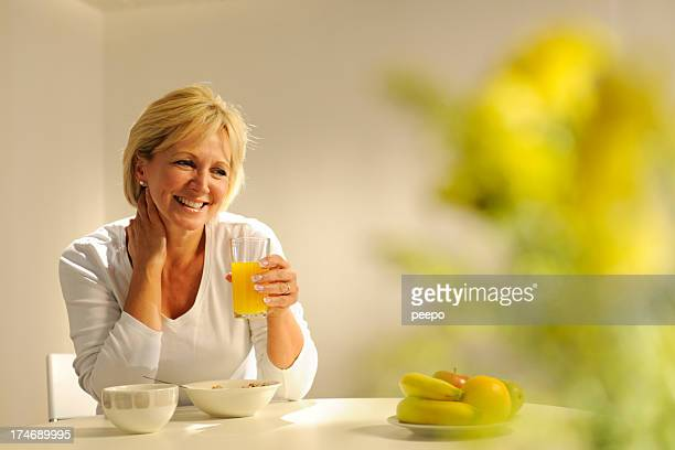 Mature Woman Eating Breakfast