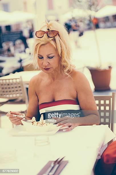 Mature Woman Eating Ice Cream