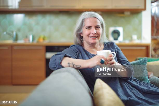 Mature woman enjoying a cup of coffee