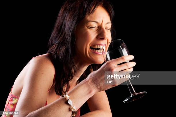 Mature woman enjoying a glass of red wine