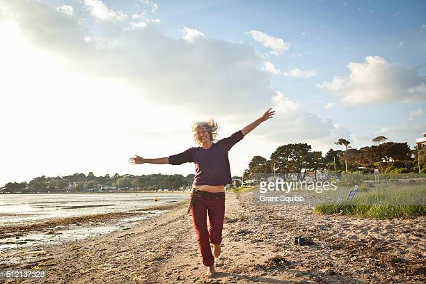 Mature woman enjoying beach