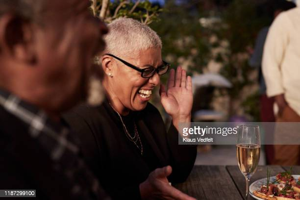 mature woman enjoying party at home - disruptaging stock pictures, royalty-free photos & images