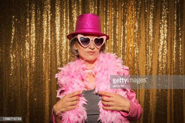 mature woman enjoying party - boa stock pictures, royalty-free photos & images
