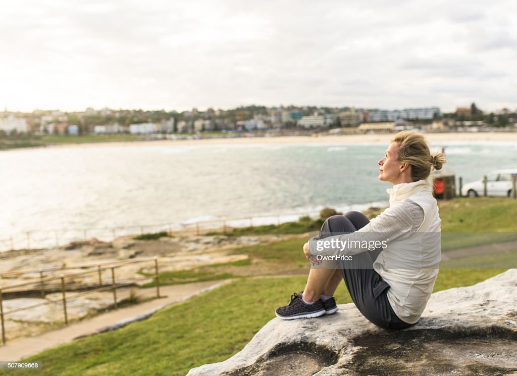 Mature woman enjoying the ocean view Sydney Australia : Stock Photo