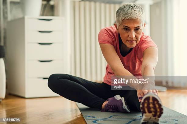 Mature Woman Exercise At Home.