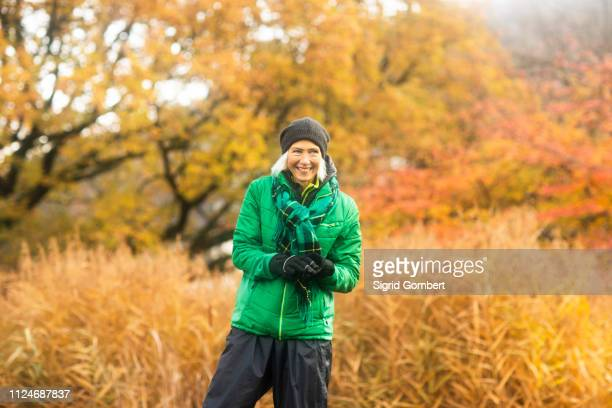 mature woman exercising in park - sigrid gombert stock pictures, royalty-free photos & images