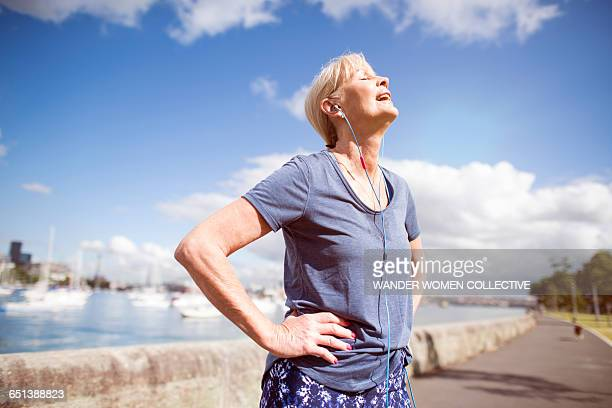 Mature woman exercising listening to music