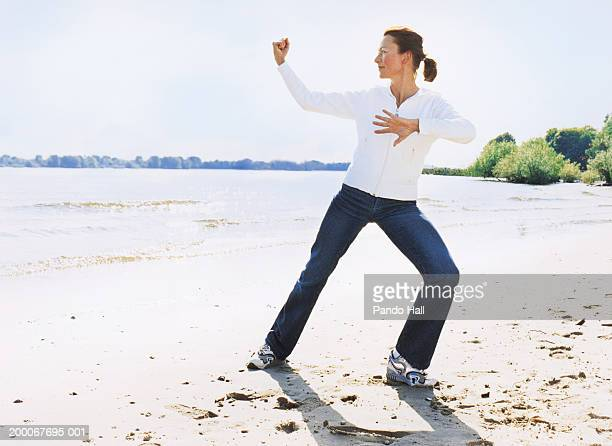 Mature woman exercising on beach
