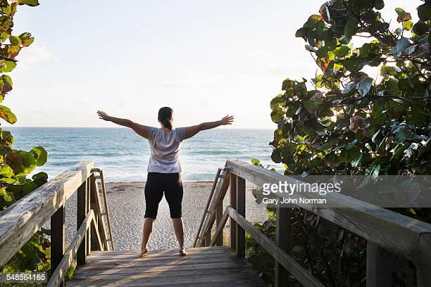 mature woman exercising on walkway, juno beach, florida, usa - juno beach florida stock pictures, royalty-free photos & images