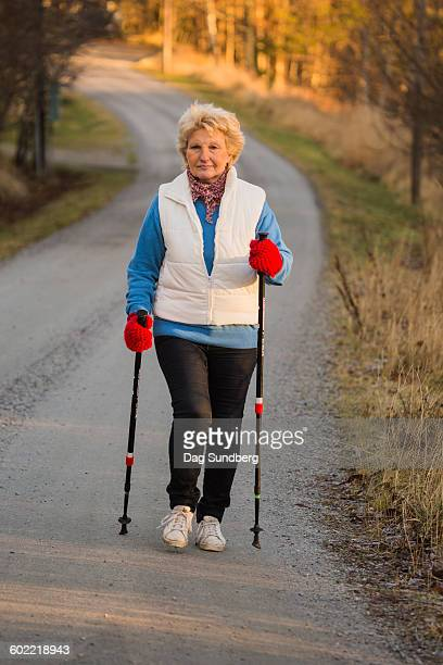 Mature woman exercising with Nordic walking