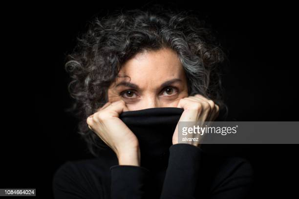 mature woman feeling cold - turtleneck stock pictures, royalty-free photos & images