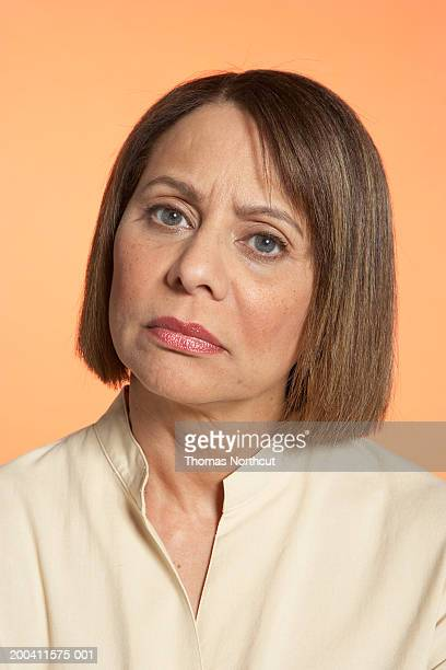 mature woman frowning, portrait - frowning stock pictures, royalty-free photos & images