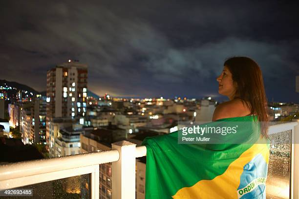 mature woman gazing from balcony at night, rio de janeiro, brazil - international soccer event stock pictures, royalty-free photos & images